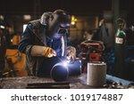 welder in protective uniform... | Shutterstock . vector #1019174887