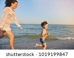 mother and child playing on the ...   Shutterstock . vector #1019199847