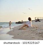 the kid is running on the beach ...   Shutterstock . vector #1019225167