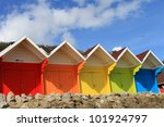 Row Of Colorful Beach Huts Wit...