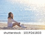 young woman sitting on the...   Shutterstock . vector #1019261833