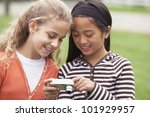 multi ethnic girls looking at... | Shutterstock . vector #101929957