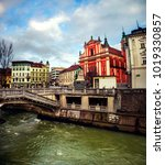 Small photo of Ljubljana, Slovenia. Triple Bridge with church and famous old buildings in the city center. Cloudy day in Ljubljana, Slovenia