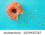 pink donut with colorful icing... | Shutterstock . vector #1019432767