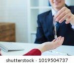 young male broker giving keys...   Shutterstock . vector #1019504737