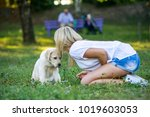 beautiful girl playing with a...   Shutterstock . vector #1019603053