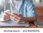 male hand texting message on... | Shutterstock . vector #1019605093