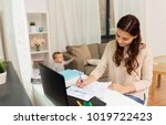 motherhood  multi tasking ... | Shutterstock . vector #1019722423