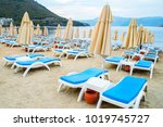 sun loungers on a beach in... | Shutterstock . vector #1019745727