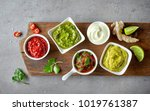 various dip sauces on grey... | Shutterstock . vector #1019761387