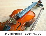 violin with a bow lying on a mat from a bamboo - stock photo