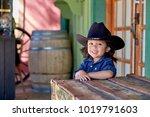 toddler boy wearing a cowboy...