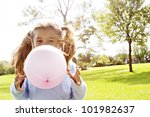 Young Girl Blowing A Pink...