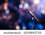 microphone on a stand up comedy ... | Shutterstock . vector #1019892733