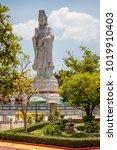 Small photo of Statue of Chinese Goddess of Mercy at Kuang Im Chapel near River Kwai, Kanchanaburi, Thailand. Vertical image.
