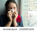 teenage girl with a cold... | Shutterstock . vector #1020091633