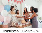 women toasting with juices at... | Shutterstock . vector #1020093673