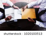 business partners signing... | Shutterstock . vector #1020103513