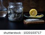 Small photo of Sandwich with sprat. Salted sprat in a glass jar.