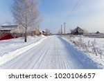 road in the snow in the village   Shutterstock . vector #1020106657