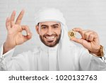 studio portrait of a smiling... | Shutterstock . vector #1020132763