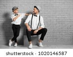 father and son in elegant suits ...   Shutterstock . vector #1020146587