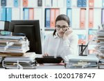 young bored office worker... | Shutterstock . vector #1020178747