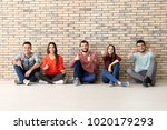 group of young people sitting