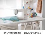 sewing machine with fabric on... | Shutterstock . vector #1020193483