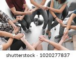 people holding hands together... | Shutterstock . vector #1020277837
