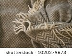 Small photo of Texture woolen plaid with folds. For use in advertising and other.