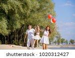 mom  dad and daughter walking...   Shutterstock . vector #1020312427