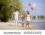 mom  dad and daughter walking...   Shutterstock . vector #1020312433