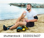 young tired man resting ... | Shutterstock . vector #1020315637