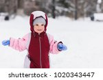 child playing in the park in... | Shutterstock . vector #1020343447