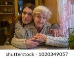 portrait of an elderly woman... | Shutterstock . vector #1020349057