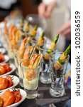 Glasses with seafood snacks -  banquet dish - stock photo