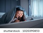 happy young couple lying in bed ... | Shutterstock . vector #1020390853