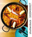 Small photo of Prawn with rice - closeup of prawn with rice - traditionnal spanish food paella