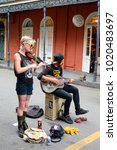 Small photo of New Orleans, LA, USA October 27, 2015 Two musicians enterain the locals and tourists alike with folk and jazz songs in the French Quarter in New Orleans, Louisiana