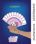 new indian currency in hand... | Shutterstock .eps vector #1020506443