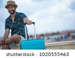 young man holding his suitcase | Shutterstock . vector #1020555463