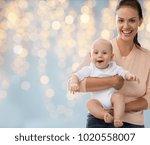 family  motherhood and people... | Shutterstock . vector #1020558007