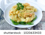 Small photo of Indonesian Snack Bakwan ,vegetables fritter served with fresh green chilli