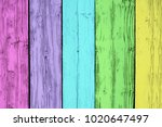 Small photo of Soft bright multicolored wood surface, with an abstract and expressive wooden texture. Salient pastel background for design