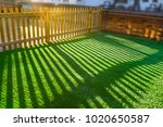 shadows of  a wooden picket... | Shutterstock . vector #1020650587