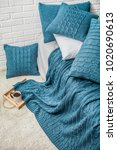 Small photo of interior bedroom decor plaid plaid turquoise with patterns pigtail texture and wall white brick
