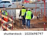 construction site workers | Shutterstock . vector #1020698797