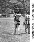 Small photo of DETROIT – AUGUST 10, 1979: people shooting in a Dearborn public park. Vintage picture taken in 1979.