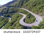 aerial view on road serpentine... | Shutterstock . vector #1020729337